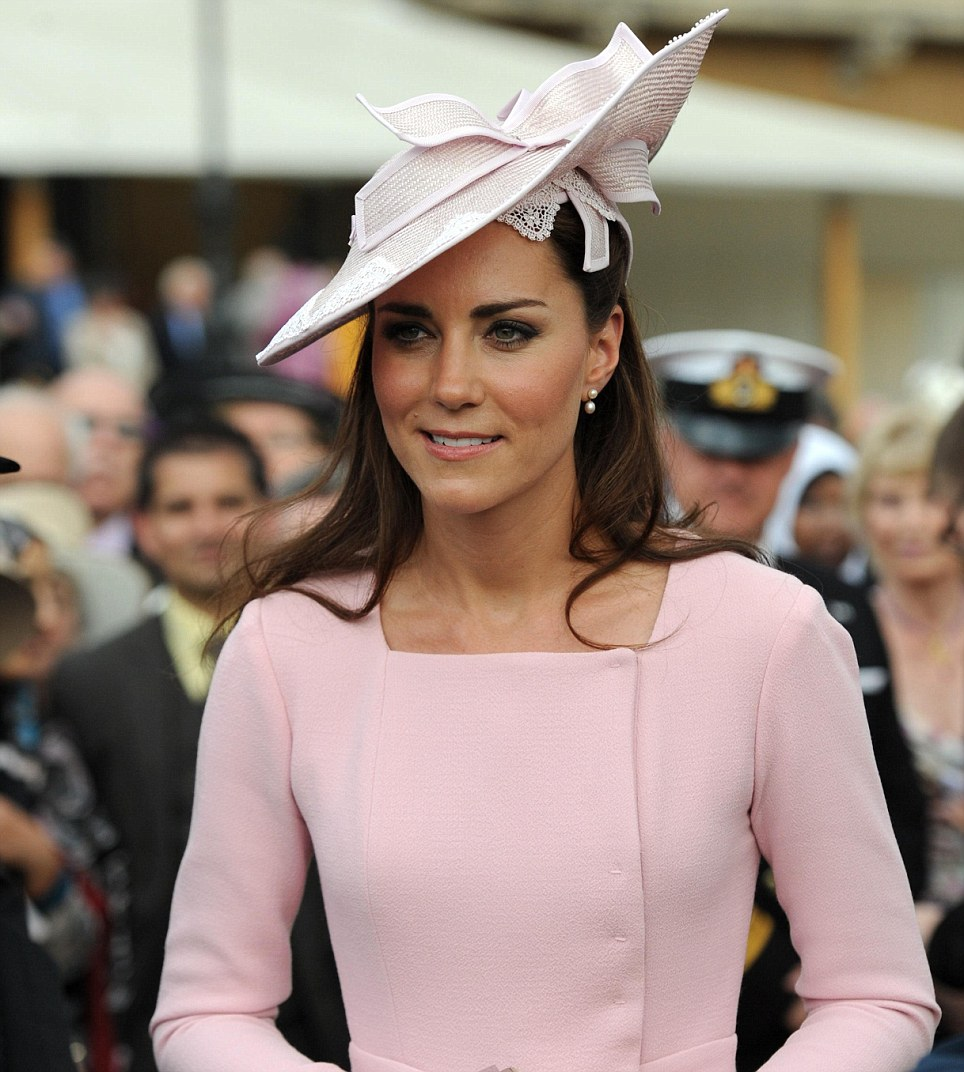 The Duchess of Cambridge meets guests during a garden party at Buckingham Palace, London. PRESS ASSOCIATION Photo. Picture date: Tuesday May 29, 2012. See PA story ROYAL Party. Photo credit should read: Anthony Devlin/PA Wire